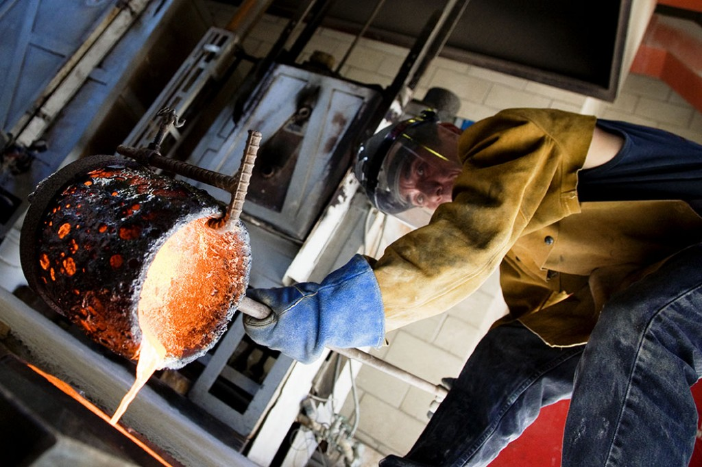 Sculptor Frank Sheriff at the University of Hawaii foundry, poring bronze into one of his molds