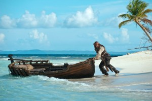 Johnny Depp pushing a boat